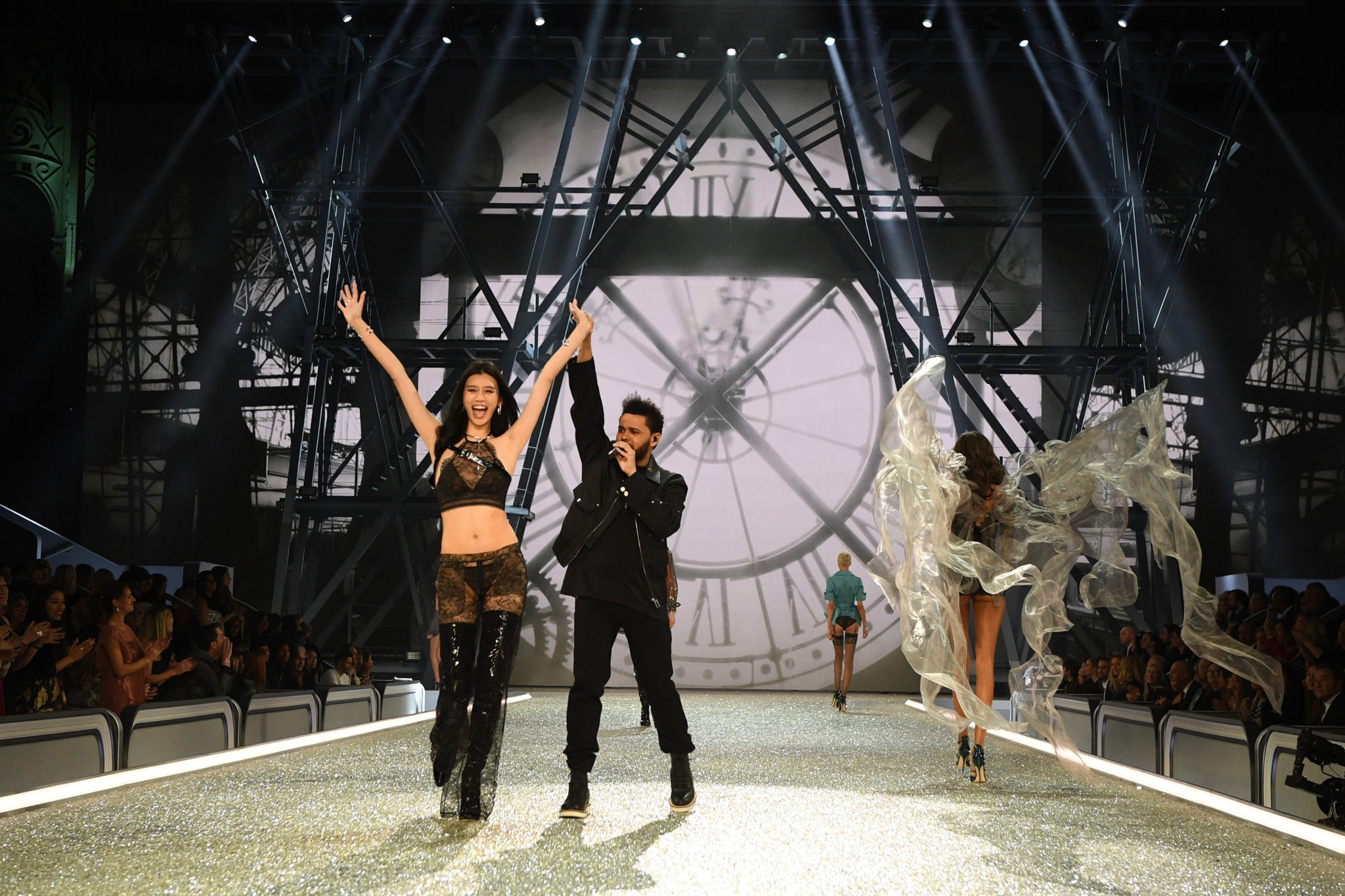 PARIS, FRANCE - NOVEMBER 30: Ming Xi walks the runway while The Weeknd performs during the 2016 Victoria's Secret Fashion Show on November 30, 2016 in Paris, France. (Photo by Dimitrios Kambouris/Getty Images for Victoria's Secret)